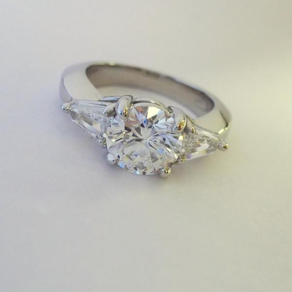 Prong Set Engagement Ring with Diamond Side Stones
